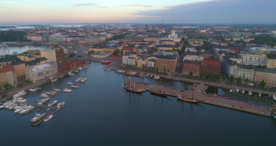 Morning in a city, C4k aerial tilt out view of the cityscape and churches of Helsinki, on a sunny summer sunrise and dawn, in Helsinki, Uusimaa, Finland | Shutterstock HD Video #1013061572