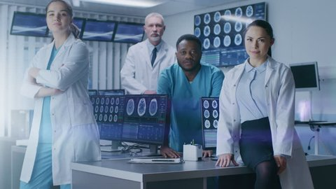 Diverse Team of Medical Scientist Posing with Crossed Arms in the High-Tech Laboratory. Brain Sceince / Neurology Center Research Lab. Shot on RED EPIC-W 8K Helium Cinema Camera.