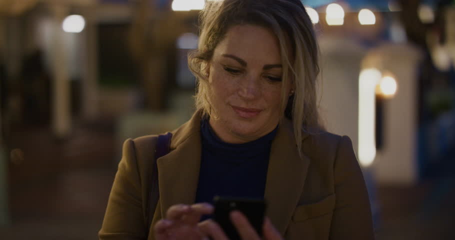 Portrait successful business woman using smartphone texting browsing online messages enjoying mobile communication in city evening slow motion   Shutterstock HD Video #1013090792
