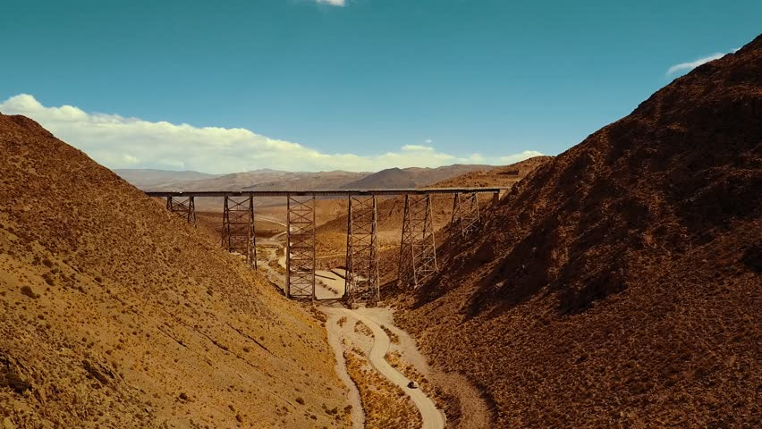 Aerial drone shot flying towards the famous Polvorilla Viaduct in Argentina