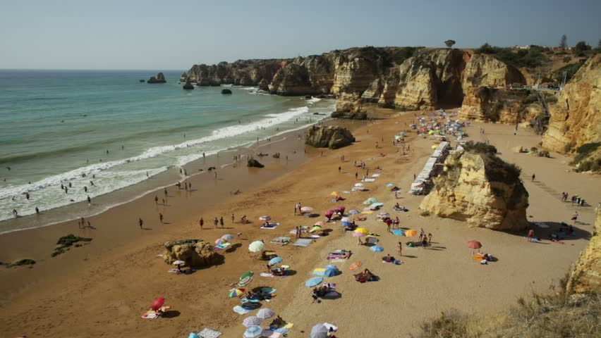 Scenic aerial view of Praia Dona Ana Beach and Lagos coastline in Algarve, Portugal, Europe. Turquoise waters between rock sandstone formations and pillars of Lagos beaches. Atlantic ocean holidays.