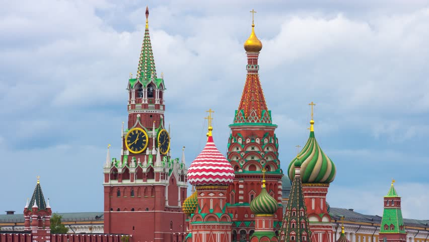 Moscow city skyline. Saint Basil's Cathedral and Kremlin Main Clock named Kuranti on Spasskaya Tower. Red Square. Timelapse.