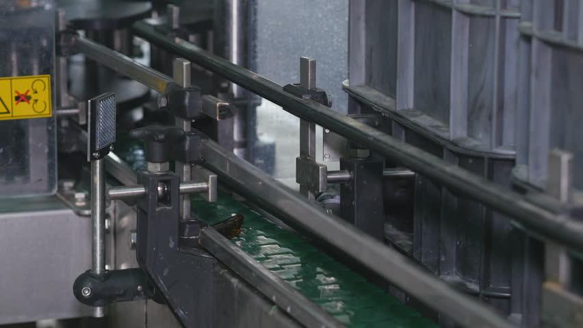 Broken bottle glass on the conveyer tape | Shutterstock HD Video #1013166212