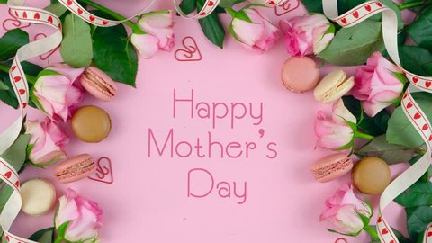 Happy Mother's Day background of pink roses and macaron cookies on pink wood tabl with animated text typography greeting.
