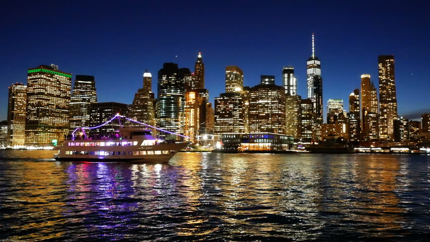 Ship navigating Hudson River against Cityscape of Lower Manhattan New York City at night | Shutterstock HD Video #1013177702