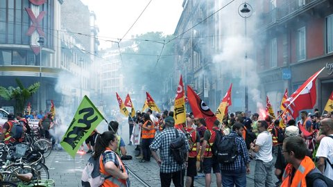 STRASBOURG, FRANCE - JUN 20, 2018: Closed central street by SNCF French train workers demonstration strike protest with smoke grenades and flares
