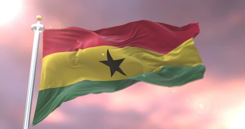 Flag of Ghana waving at wind at sunset in slow, loop