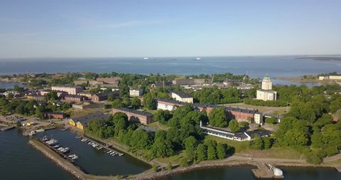 4K high quality summer morning aerial video of Helsinki Baltic Sea Finnish Bay lagoon area, city skyline, Suomenlinna Island with forts and cannons near the capital of Finland Suomi, northern Europe