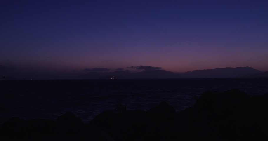 night Distant shot cruise ship sitting water magic hour There hint color sky (San Francisco,1/5/18)