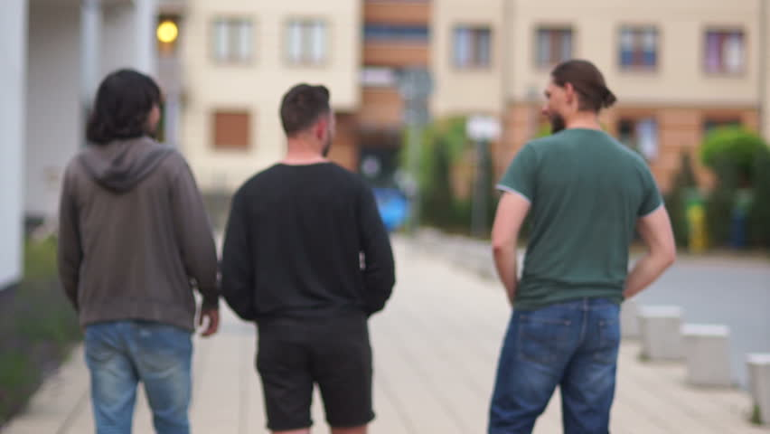 Young Men are Walking Around Stock Footage Video (100% Royalty-free)  1013350922   Shutterstock