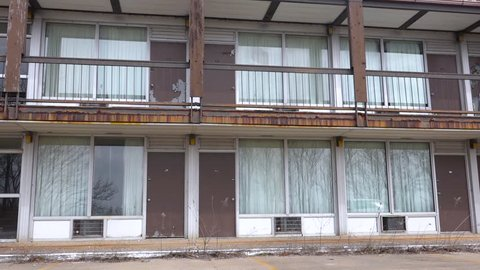MIDWEST USA - CIRCA 2017 - A sleazy abandoned motel has become a likely homeless meth lab in a rural region.