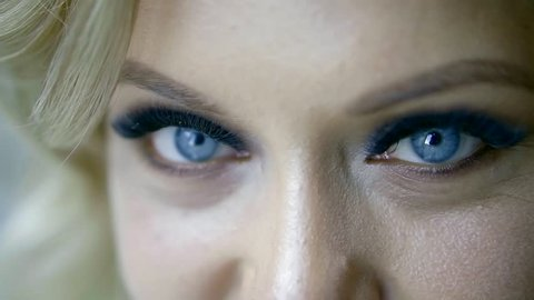 Close up portrait of a beautiful blonde model with fantastic, deep blue eyes.