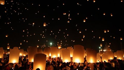 Chiang Mai, Thailand - October 25, 2014: People release sky lanterns to pay homage to the triple gem: Budhha, Dharma and Sangha during Yi Peng festival.