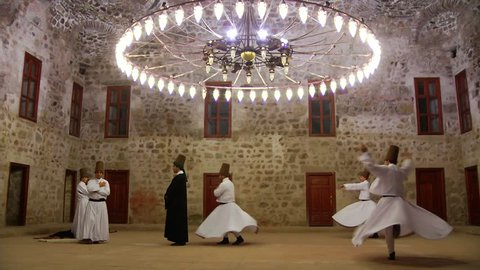 Sufi whirling dervish (Semazen) dances at Tokat. Semazen conveys God's spiritual gift to those are witnessing ritual. He spins with the music. Mevlana Celaleddin Rumi, Mevlevi. Tokat,Turkey 19.09.2013