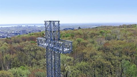AERIAL: Flying over the cross structure and Montreal city skyline. Quebec, Canada