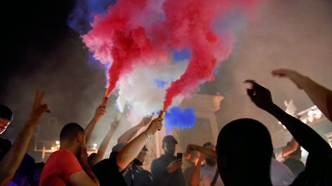 STRASBOURG, FRANCE - JULY 10, 2018: Go France, Allez Les Bleus singing fans after the victory of France qualify for the final of the 2018 FIFA World Cup after their victory over Belgium 1-0