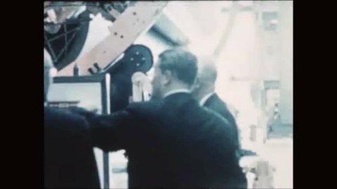 CIRCA 1960s - Aerospace engineer Wernher von Braun shows President Dwight D. Eisenhower a Saturn rocket booster.