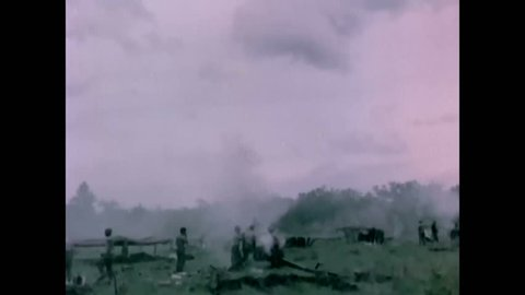 CIRCA 1966 - As part of Operation Paul Revere, the 25th infantry division clears a landing area for helicopters in a Vietnamese jungle.