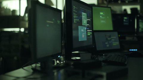 Developer and hacker hidden workstation, multiple screens and connected computers: cyber security and hacking concept