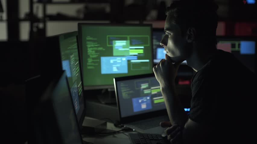 Nerd developer working late at night in his basement and hacking networks, cyber crime and coding concept | Shutterstock HD Video #1013580542