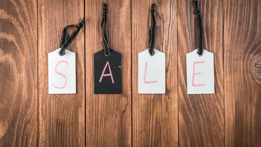 Sale on wooden label tags. Advertisement for a sale. Motion background with hanging price tags with Sale labels, stop motion, animation. Shopping sales and promotions concept | Shutterstock HD Video #1013605712