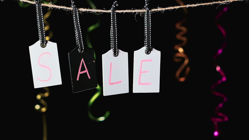 Sale on wooden label tags.Tags with black background. Advertisement for a sale. Motion background with hanging price tags with Sale labels, slow motion. Shopping sales and promotions concept. | Shutterstock HD Video #1013605802