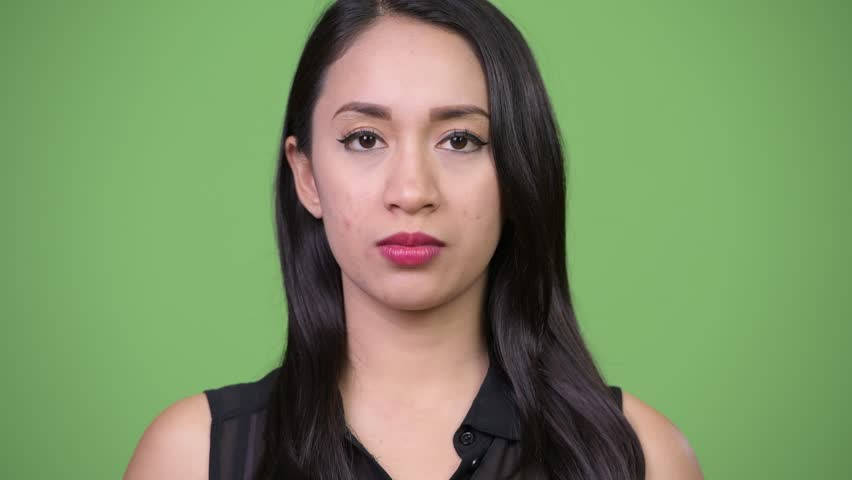Young beautiful Asian businesswoman with finger on lips   Shutterstock HD Video #1013619452