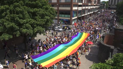BRISTOL - July 14: Pride Parade Marching With LGBTQ Rainbow Flag Through City Centre , on July 14 2018 in Bristol England.