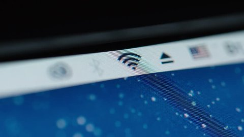 NOVOSIBIRSK, RUSSIA - JULY 3, 2018: MACRO: Fast connecting Wi-Fi icon at a monitor