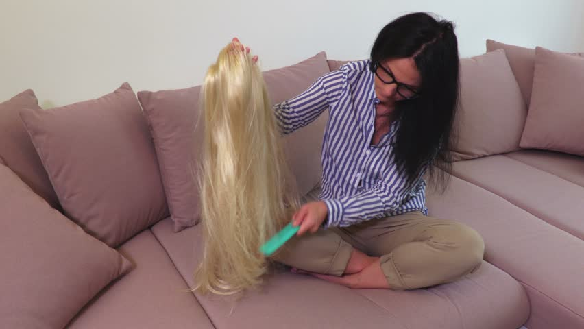 Woman combing blonde hair wig | Shutterstock HD Video #1013673242