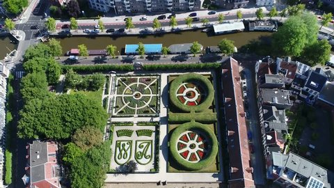 Aerial footage of the Prinsentuin in English Prince's garden or Prinsenhoftuin is garden built in renaissance style that is located in Groningen behind Prinsenhof in northern part of Holland 4k