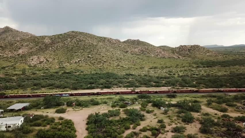 Valentine, Nevada / United States - 09 03 2017: Route 66 Freight Train Train Flyover   Shutterstock HD Video #1013705372