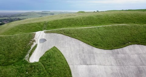 Drone aerial footage of Westbury White Horse in Wiltshire, England.