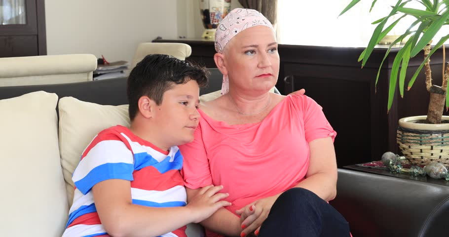 Young boy gives support his sick mother | Shutterstock HD Video #1013723672