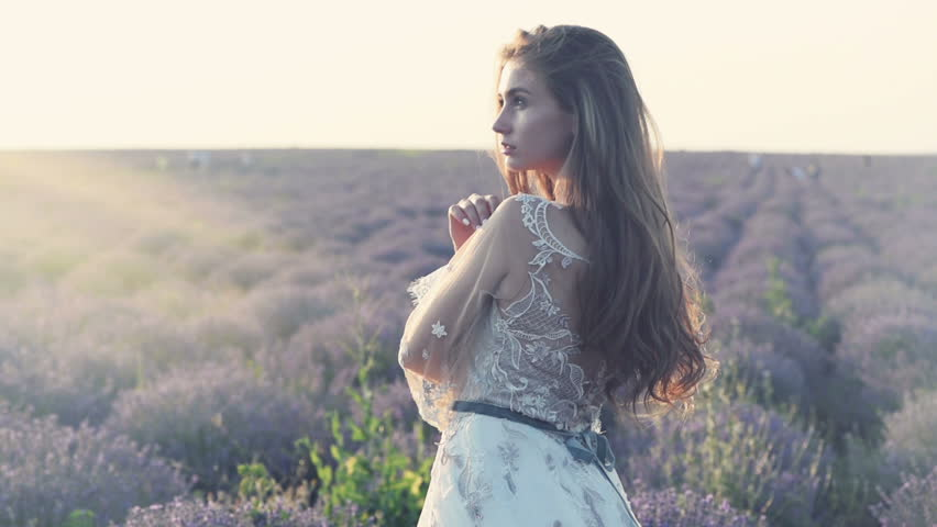 Beautiful bride in the lavender field at sunset | Shutterstock HD Video #1013726582