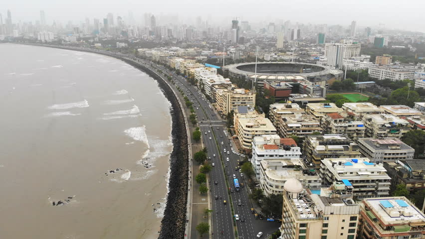 Aerial panoramic view of cityscape of Mumbai (Bombay) in monsoon season, business district skyscrapers skyline on horizon - modern capital city of Maharashtra, landscape panorama of India, Asia