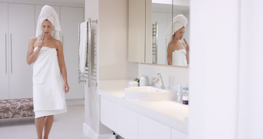 Beautiful Woman Singing In Bathroom Wearing White Towel Dancing In Front Of  Mirror RED EPIC DRAGON Stock Footage Video 10137392   Shutterstock. Beautiful Woman Singing In Bathroom Wearing White Towel Dancing In