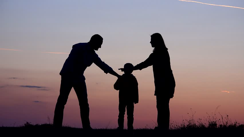 Little child and parents silhouettes put hands together and rise up to sunset sky, happy family support, conceptual | Shutterstock HD Video #1013780552