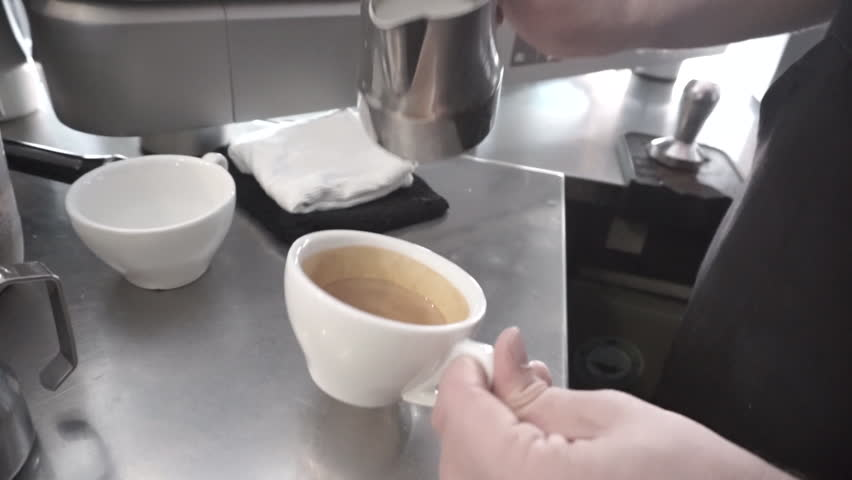 Beautiful slow motion of pouring and drawing rosetta coffee, Latte art.