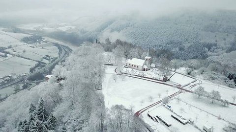 Aerial view of the Funerary Chapel for John of Luxembourg and old church St. Johannes in winter, Kastel-Staadt, Saar Valley, Rhineland-Palatinate, Germany
