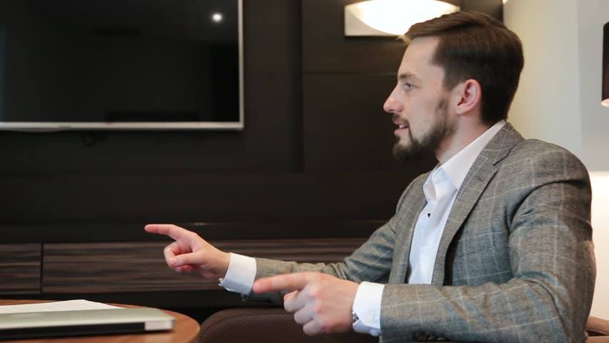 Businessman at a business meeting   Shutterstock HD Video #1013808422