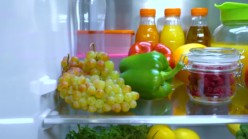 Open refrigerator filled with food. Healthy food.   Shutterstock HD Video #1013810732