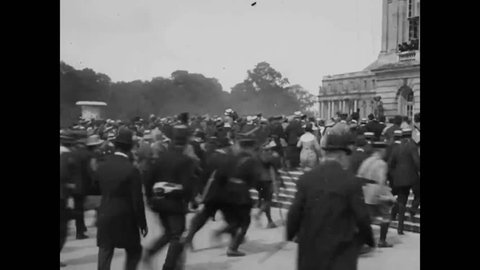 CIRCA 1919 - Crowds cheer for President Wilson, Lloyd George, and Premiers Clemenceau and Orlando outside the Palace of Versailles.