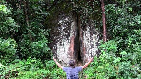 Guy is greeting the Yin Yuan Stone  in the Mount Danxia geopark. Guangdong, China