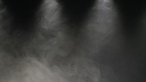 Slow motions smoke on a black background. Professional studio light and smoke machine