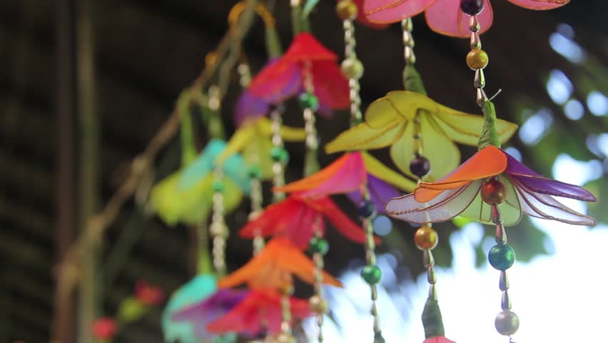Ceiling mobile with colorful flower look in market of Thailand | Shutterstock HD Video #1013894672