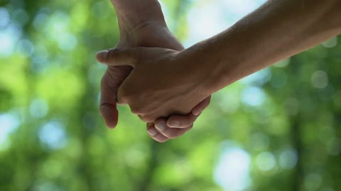 Gay couple stroking and holding hands, love feelings, romantic relationship