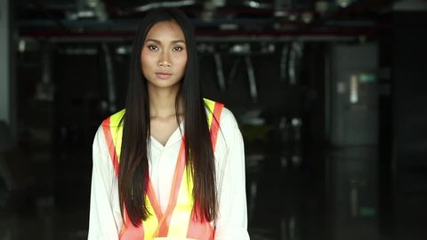 Portrait of Beautiful Asian Architect Engineer woman Long straight black hair in white hard hat, safety vast, Concept woman can do destruction construction site area room