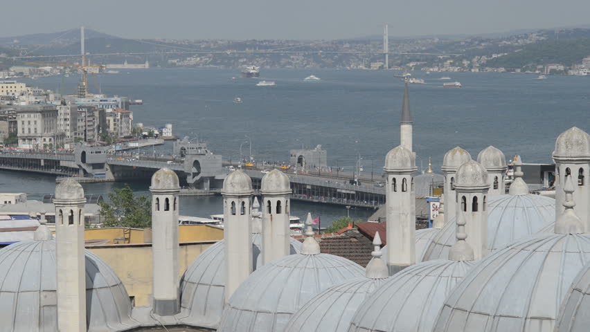 View of Istanbul over domed rooftops towards Galata bridge, the Bosphorus strait and Karaköy district.