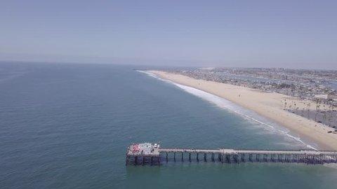 4K Newport Beach, Orange County - Flying Towards Balboa Pier And Newport Skyline  4K Beautiful Newport Beach, Orange County in Southern California. This clip is is flying from the sea towards Newport